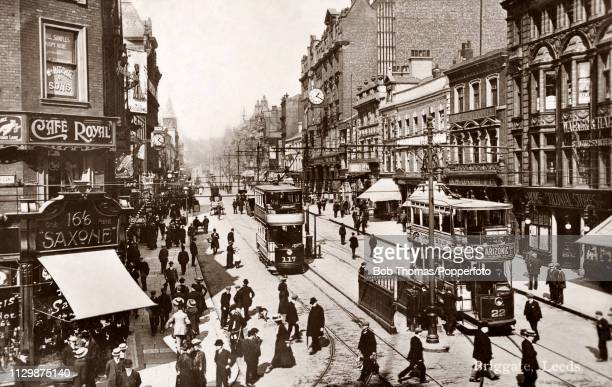 A street scene on the Briggate in Leeds England with electrified tramcars circa 1910