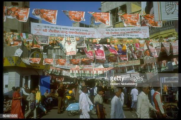 Street scene replete w parliamentary election campaign posters incl touting Congress Party ldr PM Rajiv Gandhi