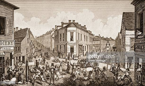 Street scene showing the notorious Five Points intersection with a crowd of people and stores New York 1829 After an old print