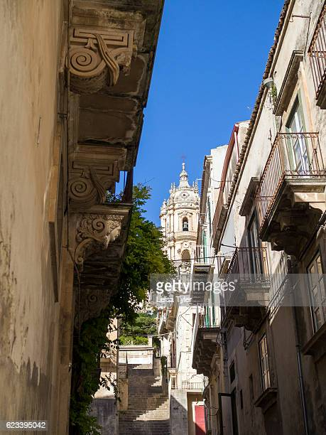 Street scene with a view of Baroque St George Church in Modica a town with World Heritage status in Sicily Locally the church is known as the Duomo...