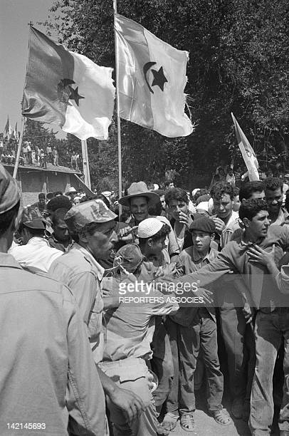 Street scene with Algerian flags after the independence during July 1962 in Algiers Algeria