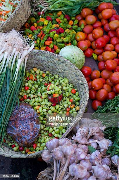 Street scene with chili peppers green onions and tomatoes being sold in Antananarivo the capital city of Madagascar