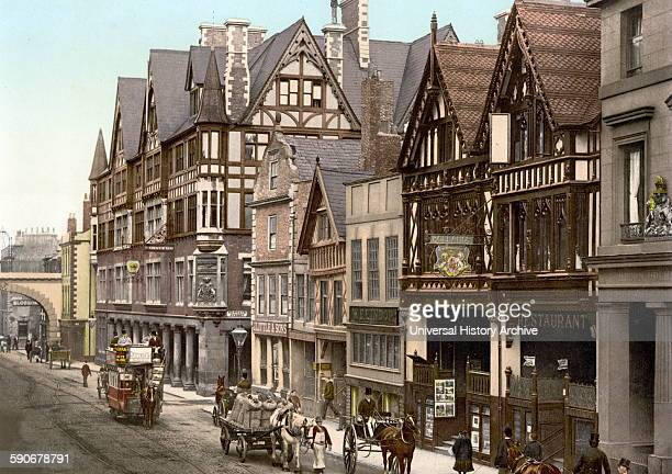 Street scene with horse drawn vehicles Eastgate Street and Newgate Street Chester England 1890