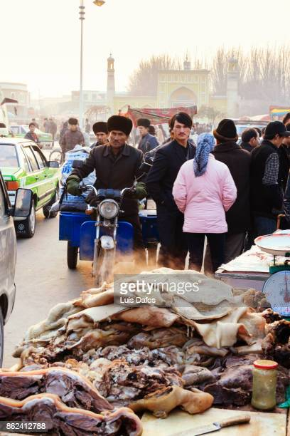 street scene with id-kah mosque in background. - dafos stock photos and pictures