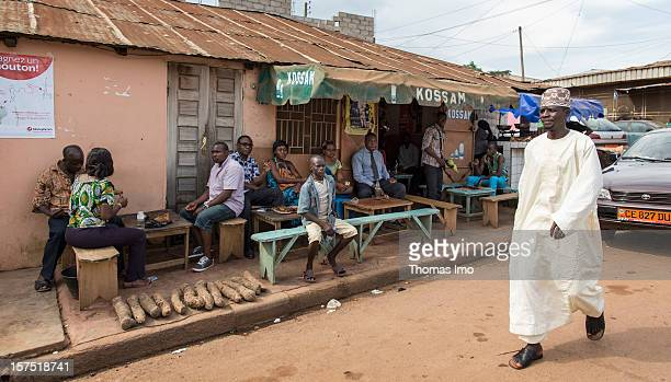 Street scene with locals sitting outside a street cafe in Yaounde, Cameroon on October 29, 2012.