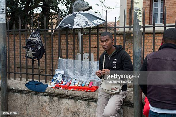 Street scene with man selling cellphones in the center of Antananarivo the capital city of Madagascar