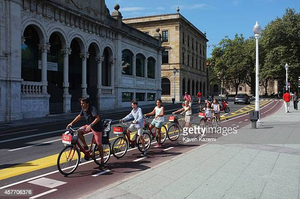 A street scene with people cycling near the waterfront on August 22 2014 in Gijon Spain