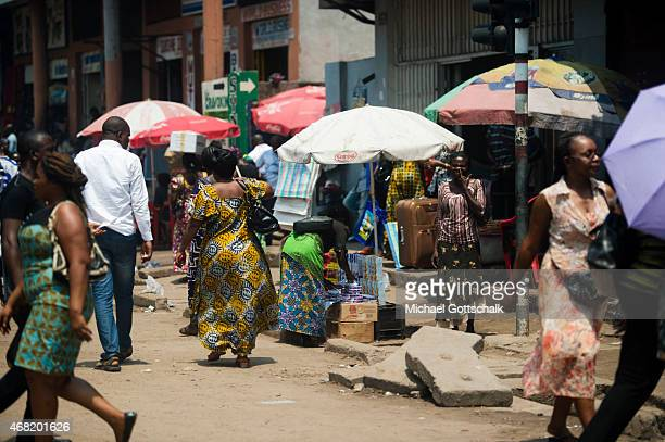 Street scene with sellers who carry loads on their heads, on March 12, 2015 in Kinshasa, Democratic Republic of the Congo.