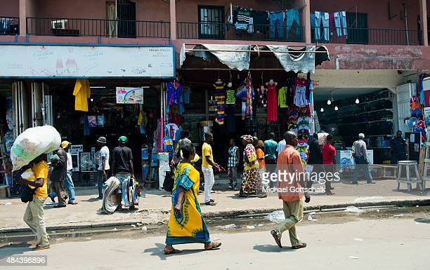 Kinshasa Democratic Republic of the Congo March 12 Street scene with sellers who carry loads on their heads on March 12 2015 in Kinshasa Democratic...