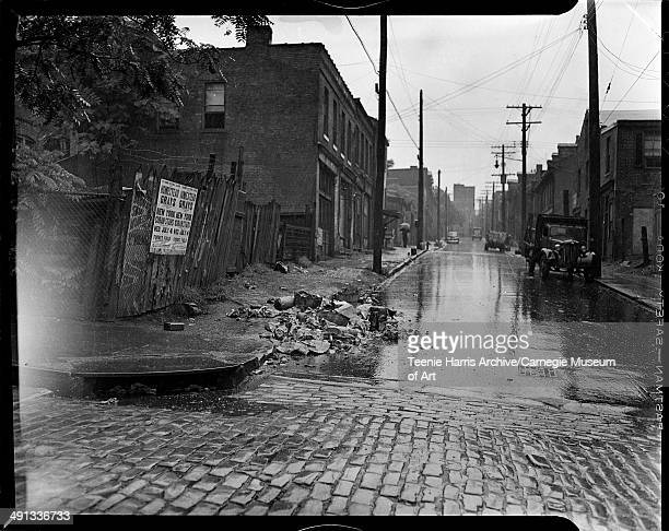 Street scene with trash and poster advertising Homestead Grays vs New York Cubans baseball game at Forbes Field Pittsburgh Pennsylvania July 4 1945