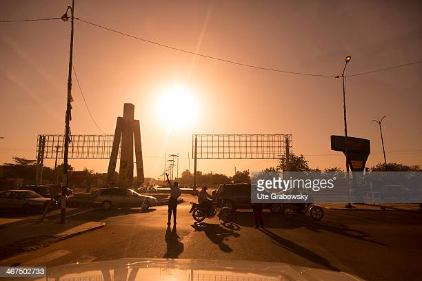 Street scenery traffic policemen regulating the urban traffic in the streets of Niamey on December 05 in Niamey Niger Photo by Ute...