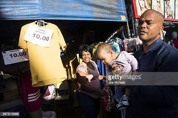 2016 Summer Olympics View of man and child in street market in Rocinha the largest favela in Brazil Rio de Janeiro Brazil 8/10/2016 CREDIT Joe McNally