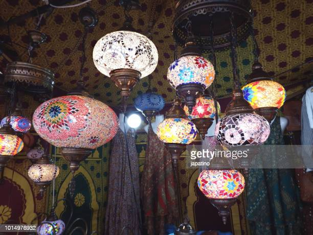 street shop selling products from morocco. colored glass lamps - lampara de aladino fotografías e imágenes de stock