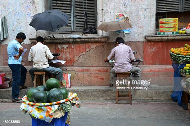 Street side Typists working in summer afternoon in the office area of Kolkata.