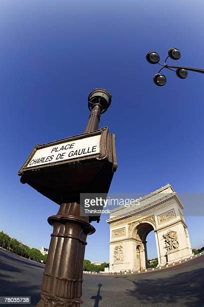 Street sign and Arc de Triomphe, Paris