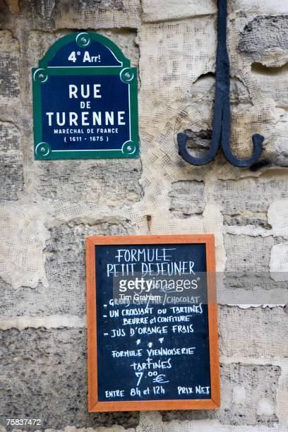 Street sign and Petit Dejeuner brasserie board rue de Turenne 4th arondissement Paris France