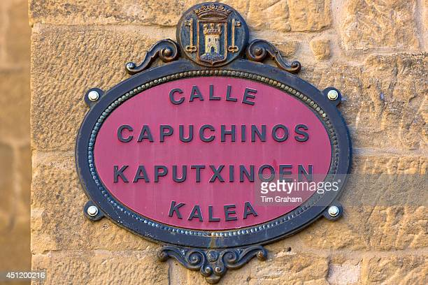 Street sign Calle Capuchinos in Spanish and Euskera Basque language in Basque town of Laguardia in RiojaAlavesa area of Spain