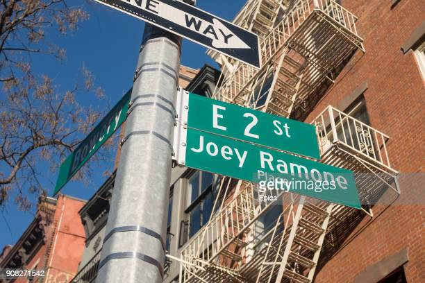Street sign for Joey Ramone Place at East 2nd and Bowery on the Lower East Side, New York. The sign pays tribute to Joey Ramone the lead singer of...