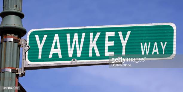 A street sign for Yawkey Way hangs near Fenway Park in Boston on March 15 2018 The street pays homage to former Red Sox owner Tom Yawkey who kept his...