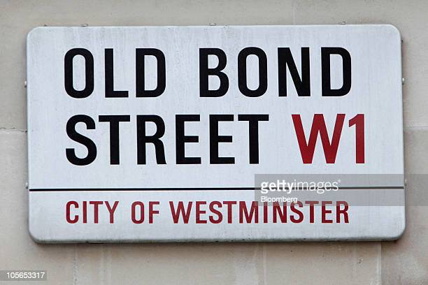 Street sign hangs on Old Bond Street, in London, U.K., on Monday, Oct. 18, 2010. U.K. Consumer spending ''is likely to be fairly restrained in...