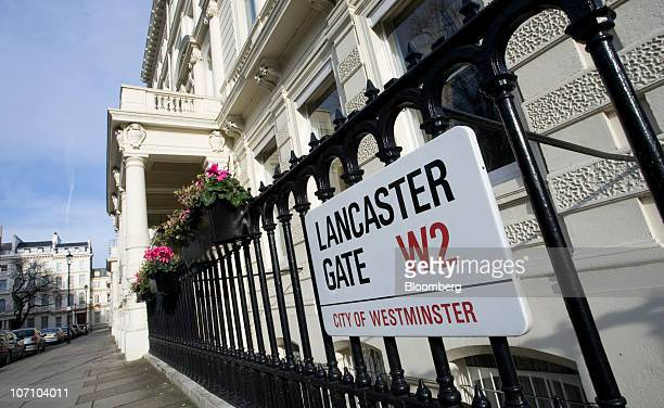 Street sign hangs on railings on Lancaster Gate in London, U.K., on Wednesday, Nov. 24, 2010. Northacre Plc, an unprofitable London developer, became...