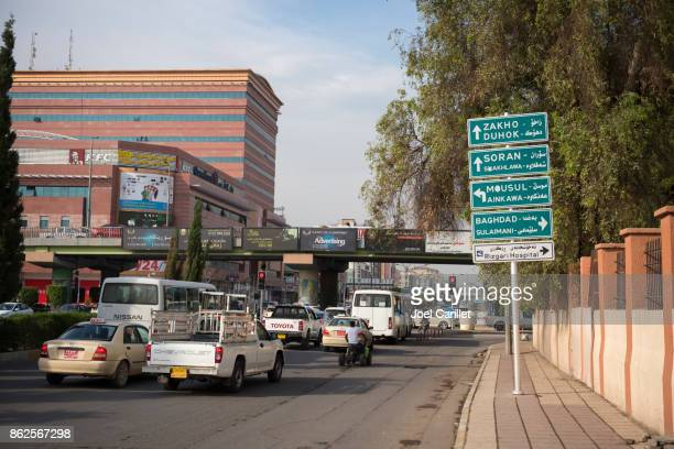street sign in erbil to various cities in iraq - baghdad stock pictures, royalty-free photos & images