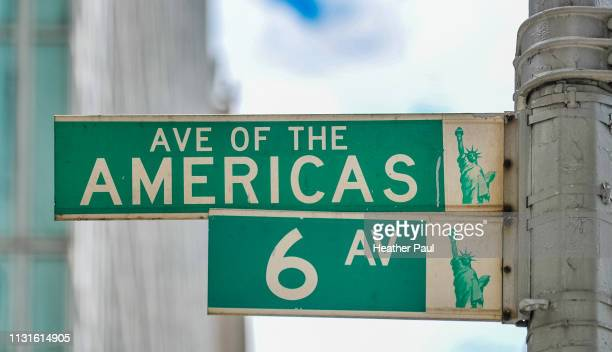 street sign in new york city for avenue of the americas and 6th avenue - sixth avenue stock pictures, royalty-free photos & images