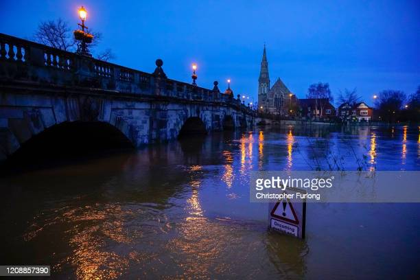 Street sign is part submerged by floodwater after the River Severn burst its banks on February 26, 2020 in Shrewsbury, England. Shrewsbury, Worcester...