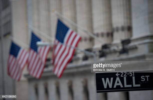 A street sign is seen near the New York Stock Exchange in New York on February 16 2017 Wall Street stocks finished mixed Thursday as a fiveday streak...