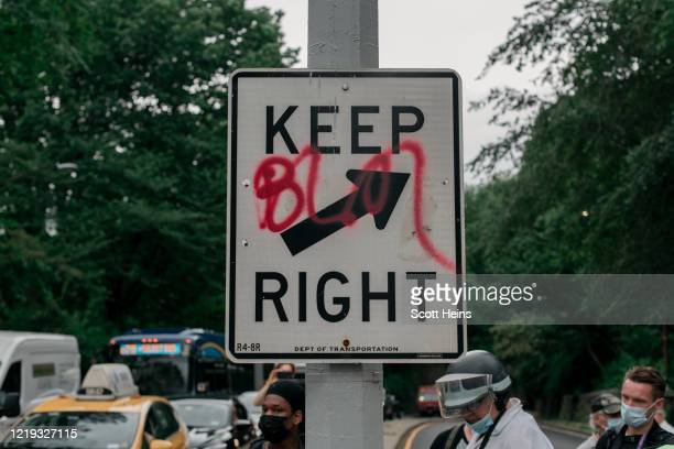 Street sign is spray painted with BLM--an acronym for Black Lives Matter--during a march against police brutality on June 11, 2020 in New York City....