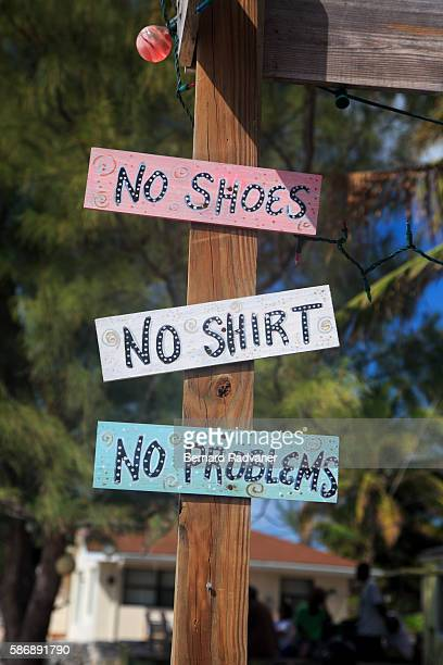 street sign no shoes no shirt no problems - bimini stock photos and pictures