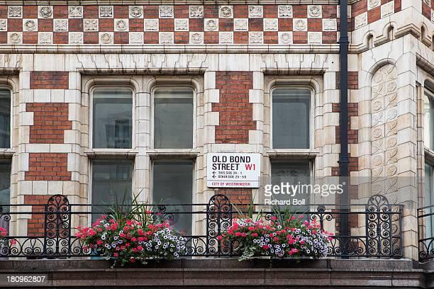 a street sign on old bond street in london - オールドボンドストリート ストックフォトと画像