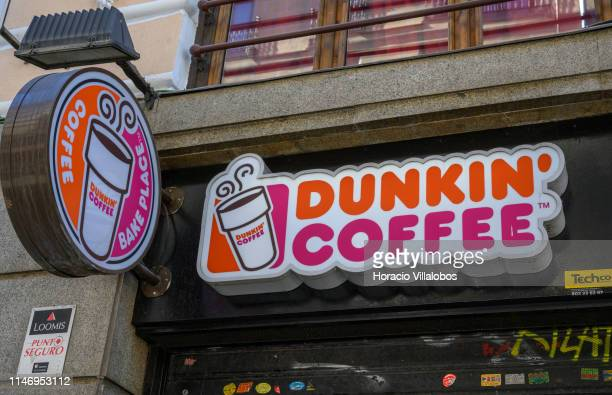 Street sign outside Dunkin' Coffee shop near Puerta del Sol square on May 04 2019 in Madrid Spain Dunkin' formerly Dunkin' Donuts is an American...