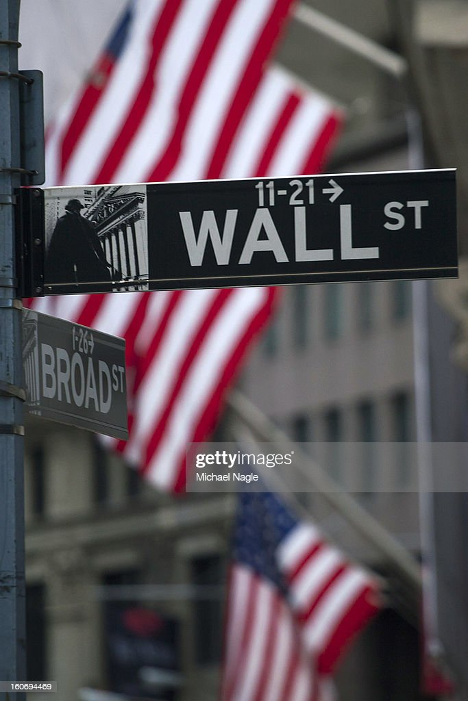 A street sign reads Wall Street in front of the New York Stock Exchange on February 4, 2013 in New York City. Stocks dropped sharply today following the Dow's close last week above 14000.
