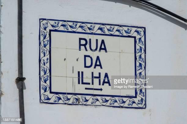 street sign - rua da ilha - rua stock pictures, royalty-free photos & images