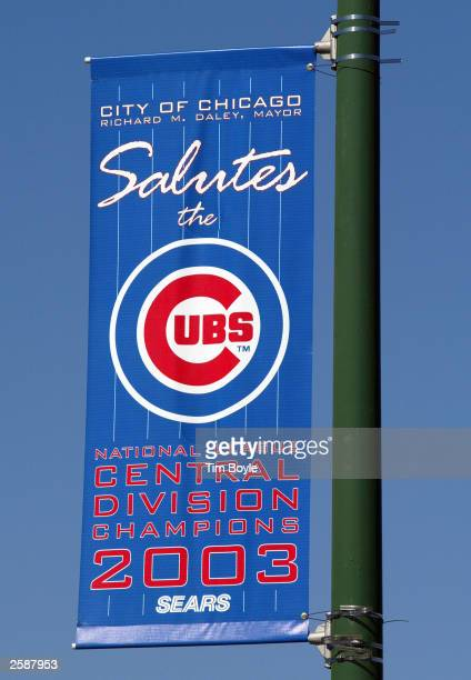 A street sign saluting the Chicago Cubs is visible outside Wrigley Field October 13 2003 Chicago Illinois The Cubs are one win away from playing in...