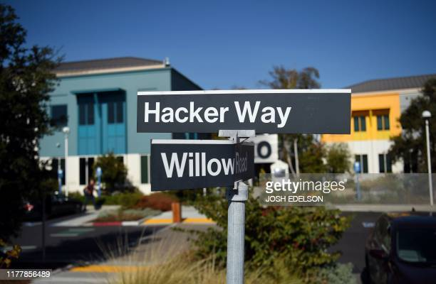 Street sign showing Hacker Way is seen at Facebook's corporate headquarters campus in Menlo Park, California, on October 23, 2019.