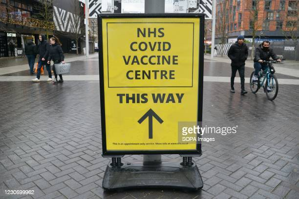 Street sign with directions to the recently opened NHS Vaccination Centre at Wembley. The site is located near Wembley Stadium, in the Olympic Office...
