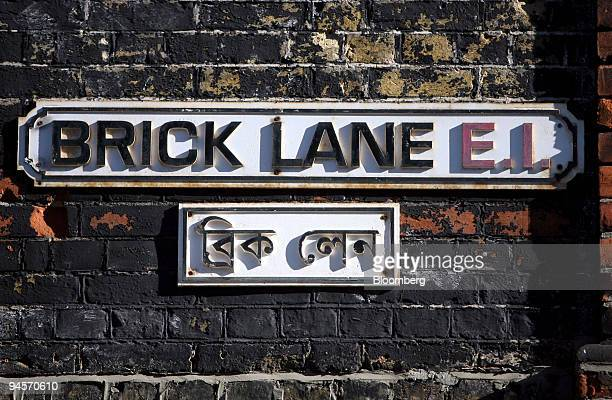 A street sign written in English and Bengali hangs on the outside of a building along Brick Lane in East London UK on Tuesday Oct 30 2007 Brick Lane...