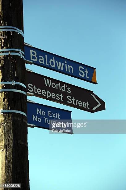 Street signage at the Jaffa candy race on Baldwin Street on July 17 2015 in Dunedin New Zealand The residential street is the steepest in the world...
