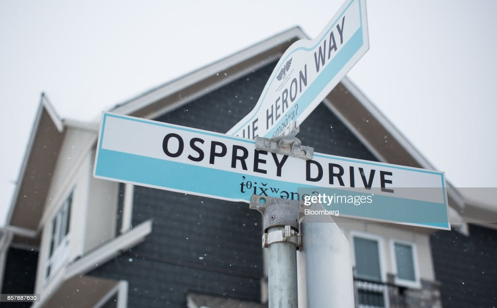 Street signs are seen at the Tsawwassen Shores residential development in Tsawwassen, British Columbia, Canada, on Wednesday, Feb. 8, 2017. The new Tsawwassen Mills mall is one manifestation of the economic boom underway in Tsawwassen First Nation, an aboriginal community about 20 miles from both downtown Vancouver and the U.S. border. Nearby, there's a master-planned residential development where homes start at C$619,900. Photographer: Ben Nelms/Bloomberg via Getty Images