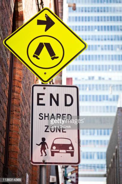 street signs in city - pedestrian crossing sign stock photos and pictures