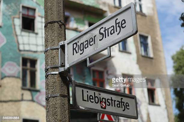 Street signs mark the intersection of Rigaer Strasse and Liebigstrasse on July 12 2016 in Berlin Germany Rigaer Strasse and especially Rigaer Strasse...