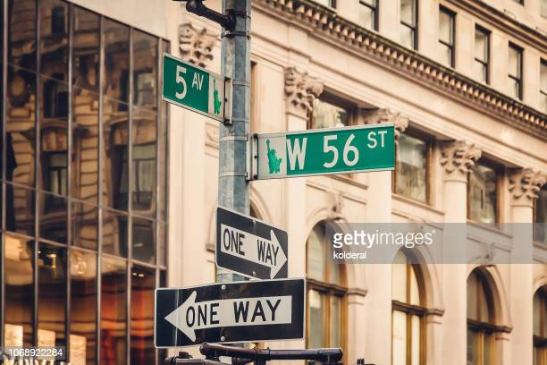 street signs of fifth avenue and w56 street - avenue stock pictures, royalty-free photos & images