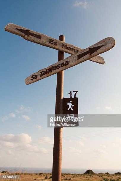 Street signs pointing to Spanish villages