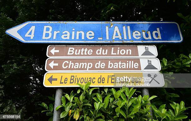 Street signs show the way to La Butte du Lion the main memorial monument of the Battle of Waterloo set where the 1815 Battle of Waterloo occured and...