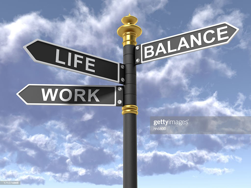 Street signs signifying a work life balance : Stock Photo