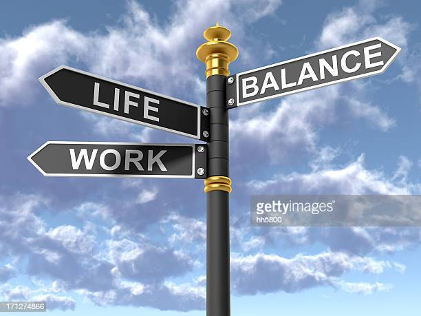 street signs signifying a work life balance - morality stock pictures, royalty-free photos & images