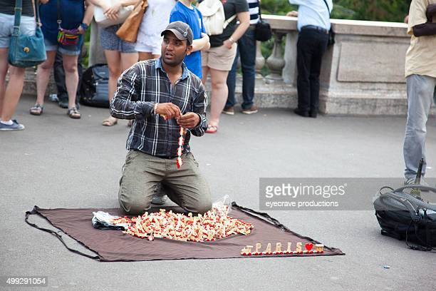 street souvenir vendors in paris in tourist area - shell game stock photos and pictures