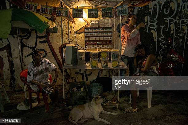 A street stall opens during the street carnival in Salvador northeastern Brazil on March 2 2014 AFP PHOTO/HIROSUKE KITAMURA